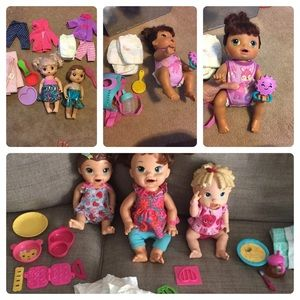 6 baby alive dolls and accessories Lot